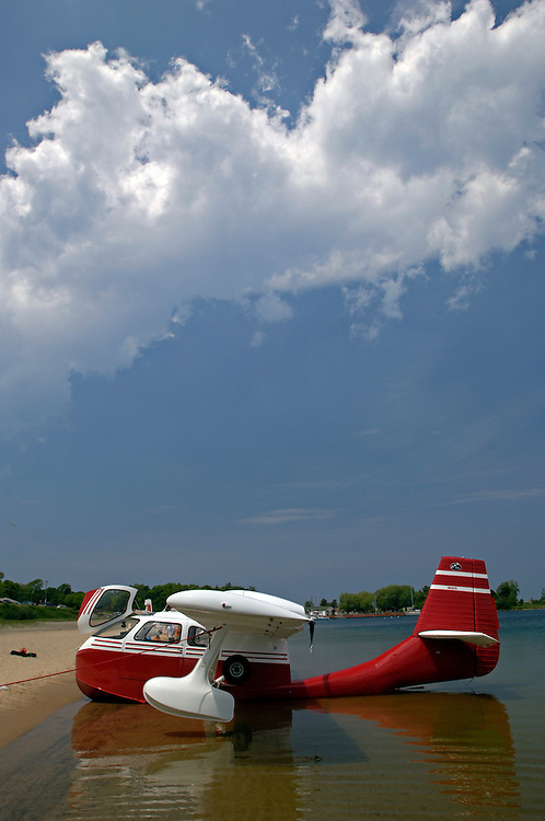 A Republic Aviation SeaBee beached in Grand Marais Michigan on Lake Superior during an annual seaplane gathering.