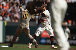 San Francisco Giants shortstop Brandon Crawford (35) tags out San Diego Padres' Jurickson Profar (10) to complete a double play during the second inning of a baseball game, Saturday, Oct. 2, 2021, in San Francisco. San Diego Padres' Ha-Seong Kim was out at first base. (AP Photo/D. Ross Cameron)
