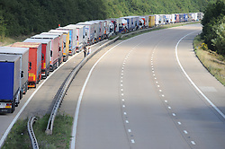 © Licensed to London News Pictures. 30/07/2015 <br /> M20 CLOSED London bound between j9/j8.<br /> Lorries stacked up between J8 and J9 M20 (this afternoon 30.07.2015).coast bound.<br /> Traffic misery continues on the M20 with Operation Stack and will most likely remain in place into the weekend.<br /> A 23-mile stretch of the coast-bound carriageway is shut with part of the London-bound side also closed.<br /> <br /> <br /> (Byline:Grant Falvey/LNP)