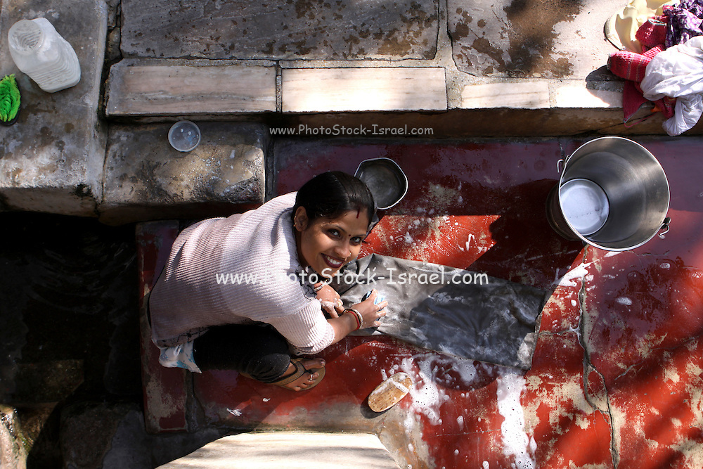 India, Uttarakhand, Rishikesh, woman washes child