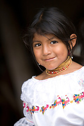 South America, Ecuador, Peguche, village of weavers near Otavalo, girl in traditional Otavaleno clothing