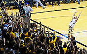 SHOT 1/21/12 6:13:20 PM - A Colorado fan leads the student section in a cheer against Arizona during their PAC 12 regular season men's basketball game at the Coors Events Center in Boulder, Co. Colorado won the game 64-63..(Photo by Marc Piscotty / © 2012)