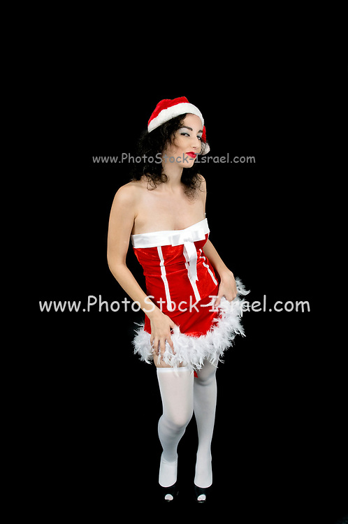 Young sexy woman in red and white mini dress wearing Santa hat on black background