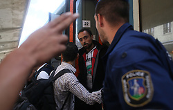 © London News Pictures. 06/09/2015. Migrants board a train travelling from Budapest to Vienna at  the train station in Gyor close to the border of Hungary and Austria, September 6 2015. Hundreds of migrants have resumed their journey through Austria to Germany after Hungary's decision on Friday to let them through.   Picture by Paul Hackett/LNP