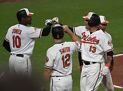 June 20, 2017 - Baltimore, MD, USA - The Baltimore Orioles' Manny Machado (13) celebrates with teammates Adam Jones (10) and Seth Smith (12) after his game-tying three-run home run against the Cleveland Indians in the fifth inning at Oriole Park at Camden Yards in Baltimore on Tuesday, June 20, 2017. The Orioles won, 6-5. (Credit Image: © Kenneth K. Lam/TNS via ZUMA Wire)