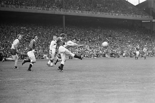 Dublin fails in a dive to block a kick from Galway down field during Dublin player holds his hands up to block Galway's kick towards the goal during the All Ireland Senior Gaelic Football Championship Final Dublin V Galway at Croke Park on the 22nd September 1974. Dublin 0-14 Galway 1-06.