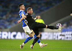 Brighton and Hove Albion's Jakub Moder (left) and West Ham United's Vladimir Coufal battle for the ball during the Premier League match at the American Express Community Stadium, Brighton. Picture date: Saturday May 15, 2021.