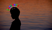 Dakotah Lee, 7 of Crystal Lake is silhouetted against Crystal Lake while wearing his light up mohawk before the start of the Crystal Lake's Independence Day fireworks on Sunday, July 7, 2019 in Crystal Lake.