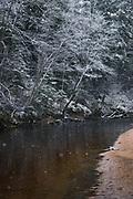 Slow falling snow and dark waters of river Amata with snow covered forest, Vidzeme, Latvia Ⓒ Davis Ulands   davisulands.com