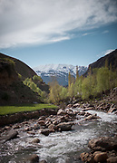 People and village of Garam Cheshma, nearby Khorog. Garam Cheshma has one of the most famous hotspring of the Pamir mountains.<br /> <br /> The town of Khorog (2200m), is the capital of the Gorno-Badakhshan Autonomous Province (GBAO) in Tajikistan. It is situated in the Pamir Mountains (ancient Mount Imeon) at the confluence of the Gunt and Panj rivers.<br /> The city is bounded to the south and to the north by the deltas of the Shakhdara and Gunt rivers, respectively. The two rivers merge in the eastern part of the city flow through the city, dividing it almost evenly until its delta in the river Panj, also being known as Amu Darya, or in antiquity the Oxus on the border with Afghanistan. Khorog is known for its beautiful poplar trees that dominate the flora of the city.<br /> Khorog is one of the poorest areas of Tajikistan, with the charitable organization Aga Khan Foundation providing almost the only source of cash income. Most of its inhabitants are Ismaili Muslims.<br /> <br /> Tajikistan, a mountainous landlocked country in Central Asia. Afghanistan borders it to the south, Uzbekistan to the west, Kyrgyzstan to the north, and People's Republic of China to the east. Tajikistan also lies adjacent to Pakistan separated by the narrow Wakhan Corridor.<br /> Tajikistan became a republic of the Soviet Union in the 20th century, known as the Tajik Soviet Socialist Republic.<br /> It was the first of the Central Asian republic to gain independence in December 1991.