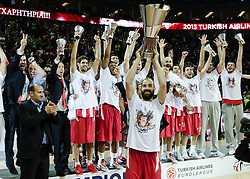 © Licensed to London News Pictures. 12/05/2013. London, UK.  Vassilis Spanoulis holds the Euroleague Final Four trophy before his Olympiacos Piraeus teammates after they beat Real Madrid (white strip) in the Final of the Euroleague Basketball Final Four at The O2 Arena.   Spanoulis was also named the league MVP (Most Valuable Player) n the climax of the tournament.  The Turkish Airlines Euroleague, commonly known as the Euroleague, is the highest level tier and most important professional club basketball competition in Europe, with teams from up to 18 different countries, members of FIBA Europe. Photo credit : Richard Isaac/LNP
