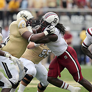 UCF Knights offensive linesman Justin McCray (64) and South Carolina Gamecocks defensive end Jadeveon Clowney (7) play during an NCAA football game between the South Carolina Gamecocks and the Central Florida Knights at Bright House Networks Stadium on Saturday, September 28, 2013 in Orlando, Florida. (AP Photo/Alex Menendez)