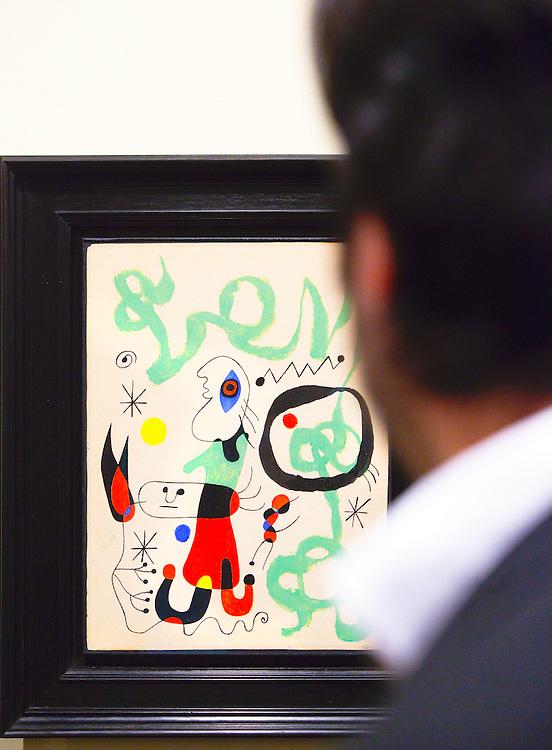 Visitor views painting by Joan Miró at the Landau Gallery at Art Basel Miami Beach 2008