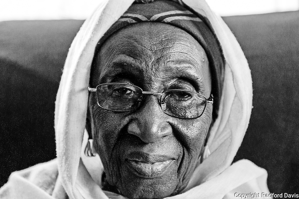 The mother of the founder of Khadarlis (a US based NGO) sits on her couch in her second floor apartment above shops and busy streets of Freetown. She's calm, peaceful. She's glad I'm there to help, she tells me. I see her twice,  while I'm in Sierra Leone, only for a few minutes each time. Its a nice visit, one I hope to make again.