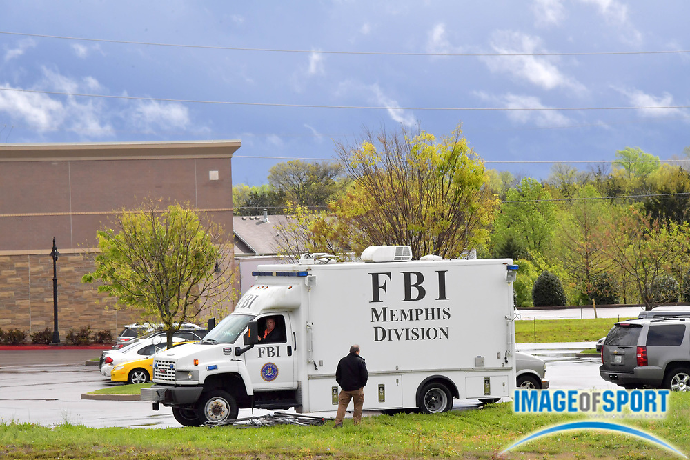 FBI vehicles near the command center across from the Waffle House on Murfreesboro Road on Monday, April 23, 2018 in Nashville, Tenn. where a shooting occurred on Sunday morning. Travis Reinking is the suspect in the shooting at the Waffle House restaurant Sunday in Nashville that resulted in the death of four people. Reinking is now in the custody of the Metro Nashville Police following a search lasting over 24 hours. (Jim Brown\IOS via AP)