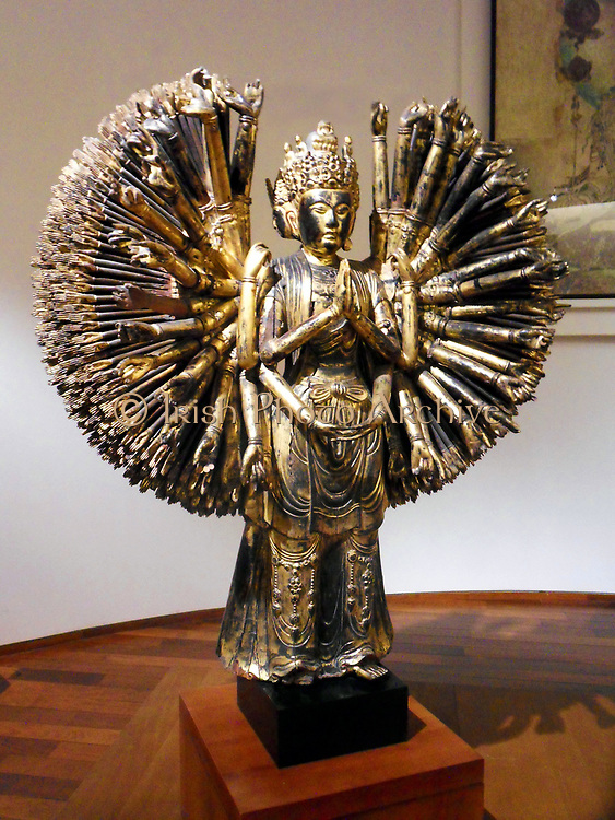 The thousand-armed bodhisattva Avalokitesvara a major Bodhisattva in Mahayana Buddhism. Sculpture, wood (material) Production site: China China, Five Dynasties (907-960) . Wood and gilt