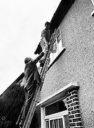 Austin Currie going to great heights to meet John Doyle as he canvasses in Palmerstown, in his quest to win a seat for Fine Gael in the General Election. Currie, a founder member of the SDLP, previously held a seat in the Northern Ireland Executive, serving as Minister for Housing and Local Planning.<br />