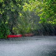 Red Canoes in the rain.Mayakoba, Riviera Maya.