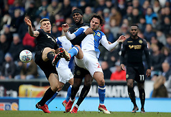 Wigan's Max Power and Cheyenne Dunkley challenge Blackburn's Bradley Dack to the ball