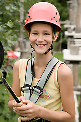 Portrait of girl climbing crag, smiling