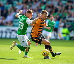 Hibernian's Fraser Murray and Alloa Athletic's Scott Taggart. Hibernian 2 v 0 Alloa Athletic, Betfred Cup game played Saturday 20th July at Easter Road, Edinburgh.