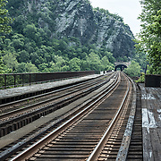 The train tracks at Harpers Ferry, West Virginia, heading east across the Potomac into Virginia.