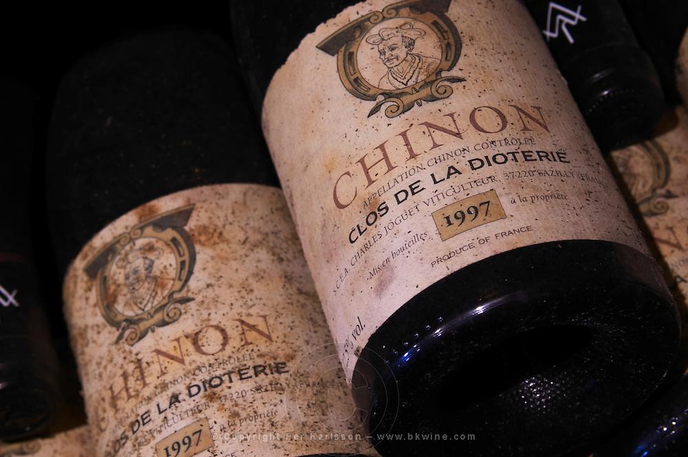 Bottles aging in the cellar. Clos 1997. Domaine Charles Joguet, Clos de la Dioterie, Chinon, Loire, France