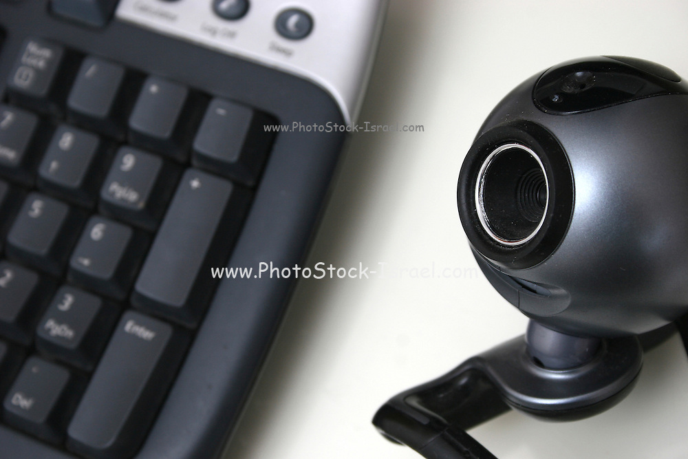 Internet Camera and computer keyboard on white background