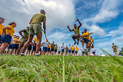 U.S. Soldiers, Sailors, Marines and Airmen take turns jumping over a rope during the Okinawa Joint Fitness Challenge Sept. 26, 2018, at Kadena Air Base, Japan. The jump rope challenge required all 48 students to jump over the rope while it was in motion. If the rope touched a student while they were jumping over, or if the rope stopped, the students would have to start over again. (U.S. Air Force photo by Staff Sgt. Micaiah Anthony)