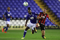Birmingham City's Jacques Maghoma (left) and AFC Bournemouth's Dan Gosling battle for the ball during the Carabao Cup, Second Round match at St Andrew's, Birmingham.