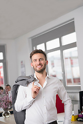 Young handsome man in office smiling