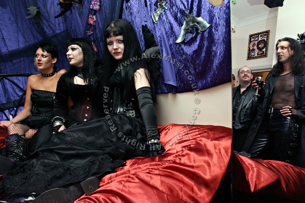 Members are enjoying a glass of wine in Cecileís bedroom in Camden Town, London, England, on Sunday, 15 October, 2006. The Vampyre Connexion is the largest and most active of all the vampire groups in the United Kingdom, counting more than 100 members that for years have gathered regularly in London to share their common love for vampires and the Dark side of life. The Connexion raised from the hashes of the Vampyre Society, the first vampire appreciation group in 1995. The group believe in the fantasy of vampires and such creatures and live it to the full. Its  roots are to be found in the legends of Bram Stokerís Dracula. The group prints its own magazine, ëDark Nightsí featuring drawings, poetry, stories, photography and events. All of the members dress very peculiar clothing, and this is a very important part of the life of the group; it is respected with pride, taste and accuracy for the detail. Most like to dress to be elegant in a range of styles from regency to Victorian, some sew their own. In addition members visit art galleries, cemeteries, churches and cathedrals, attend gigs and concerts, and hold their own parties throughout the year, Halloween being the biggest and scariest one. Membership is open to all, the only qualification: being a love of all things Vampyric.**ItalyOut**