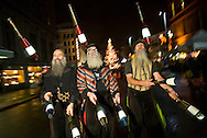 Jugglers Alan Fitzhum, left, Harry Levine, center, and Dough Martin, right, of the Mud Bay Jugglers march down Broadway during a First Night parade. Cliant: The News Tribune