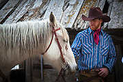 A cowboy and his horse on a rnach in northeastern Wyoming