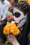A Mexican woman dressed as La Calavera Catrina for the Day of the Dead or Día de Muertos festival October 31, 2017 in Patzcuaro, Michoacan, Mexico. The festival has been celebrated since the Aztec empire celebrates ancestors and deceased loved ones.