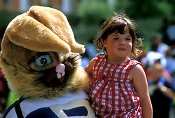 Young Girl Being Carried by Person Dressed in Bunny Costume
