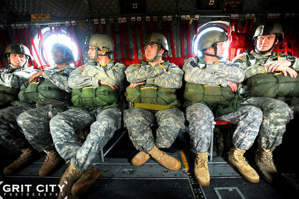 Soldiers prepare to perform a static line jump from a CH-47 Chinook helicopter March 18 near Rogers Drop Zone. The Soldiers jumped one at a time while waiting for a ground counterpart to call in the parachute drop zone during Pathfinder badge training on JBLM.