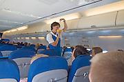 KLM sturdiest demonstrating the use of oxygen mask in case of emergency. Amsterdam Netherlands