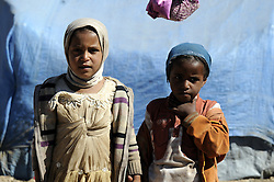 SANAA, Oct. 29, 2016 (Xinhua) -- Displaced girls stand outside their tent at an internally displaced camp at Amran province, north Sanaa, Yemen on Oct. 29, 2016. According to UN, 14.1 million people in Yemen are food insecure, of whom 7.6 million are one step from famine due to the civil war and Saudi-led bombing campaign. (Xinhua/Mohammed Mohammed) (Credit Image: © Mohammed Mohammed/Xinhua via ZUMA Wire)