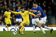 Chelsea midfielder Eden Hazard (10) holdsoff Everton defender Michael Keane (4) during the Premier League match between Everton and Chelsea at Goodison Park, Liverpool, England on 17 March 2019.