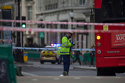 Licensed to London News Pictures. 28/09/2020. London, UK. Police guard a scene after the bus hit a woman in Oxford Circus, central London. Photo credit: Marcin Nowak/LNP
