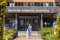 © Licensed to London News Pictures; 27/05/2020; Weston-super-Mare, UK. Staff are seen in front of Weston General Hospital which has been closed to all new admissions including to the accident and emergency department following an increase in cases of Covid-29 coronavirus being treated at the hospital. It's also reported that 40% of the hospital's staff have tested positive for coronavirus but many have no symptoms. Today mobile coronavirus test centre staffed by the army has opened in the town, to test for coronavirus during the Covid-19 pandemic. Photo credit: Simon Chapman/LNP.