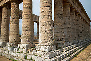 Tourists visiting the ancient ruins of the stone Doric Temple of Segesta, Sicily, Italy