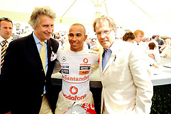 Left to right, ARNAUD BAMBERGER, LEWIS HAMILTON and the EARL OF MARCH at a luncheon hosted by Cartier for their sponsorship of the Style et Luxe part of the Goodwood Festival of Speed at Goodwood House, West Sussex on 4th July 2010.