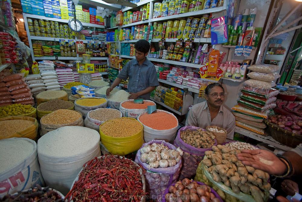 Vendors prepare their stall for a busy day at the Santinagar  market in Dhaka, Bangladesh.