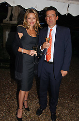 NICK BARHAM and KAREN CARWIN at the annual Chelsea Flower Show dinner hosted by jewellers Cartier at the Chelsea Pysic Garden, London on 22nd May 2006.<br /><br />NON EXCLUSIVE - WORLD RIGHTS