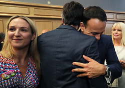 An Taoiseach Leo Varadkar (right) and Minister for Health Simon Harris embrace at Dublin Castle as the official results of the referendum on the 8th Amendment of the Irish Constitution are announced in favour of the yes vote. Picture date: Saturday May 26, 2018. See PA story IRISH Abortion. Photo credit should read: Brian Lawless/PA Wire