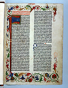 Page of 'Bible' printed by Gutenberg, 1456. Illuminated border typical of a manuscript.