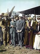 On the airfield at Amman,  Jordan, April 1921:  T E Lawrence,  Sir Herbert Samuel (British High Commissioner of Palestine), Emir Abdullah. Woman far left, possibly Gertrude Bell. Sheik Majid Pasha el Adwan, far right.