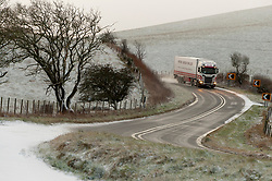 © Licensed to London News Pictures. 28/01/2020. Llanfihangel-nant-Melan, Powys, Wales, UK. A truck negotiates hazardous conditions on the A44 near the small Welsh village of Llanfihangel-nant-Melan in Powys, Wales, UK. Photo credit: Graham M. Lawrence/LNP